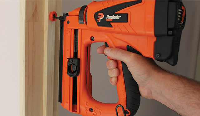 Paslode nail gun being used on door surround